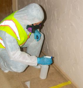 spraying asbestos to prevent flaking